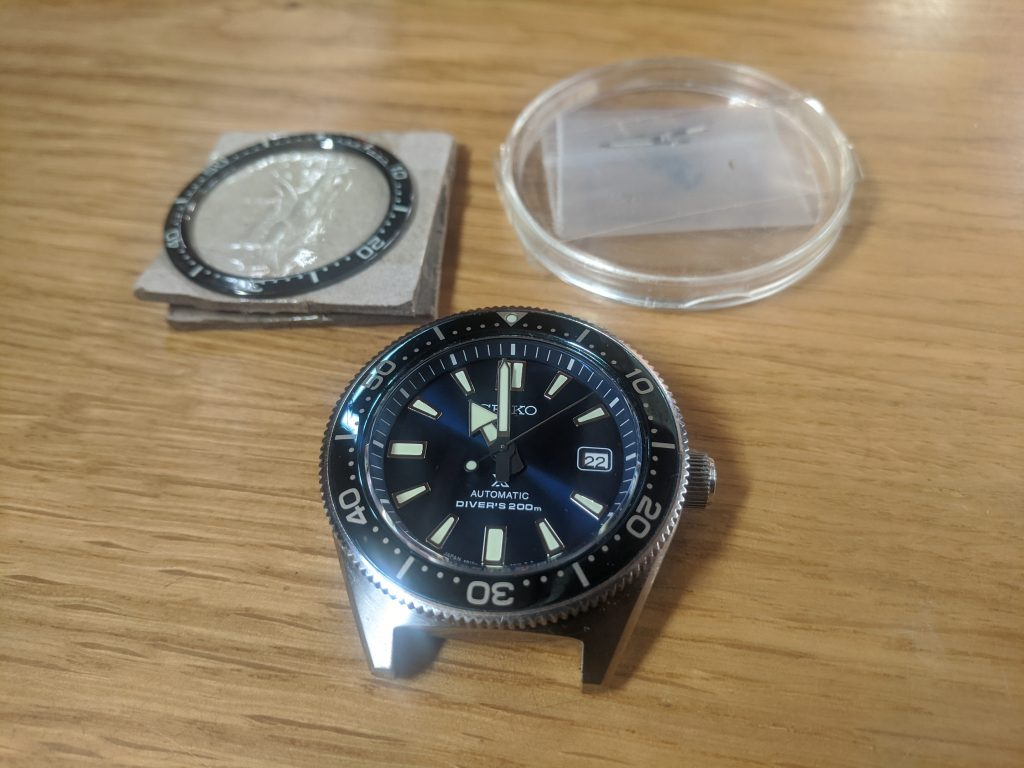 Seiko Prospex Air Diver Mod - displayed with the new parts for modding. New hands and bezel to be fitted by wellingtime