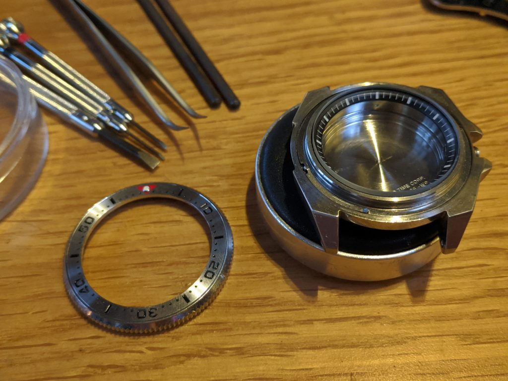 Seiko Samurai displayed on watchmakers cushionwith bezel removed so the bezel spring can be repaired here at wellingtime