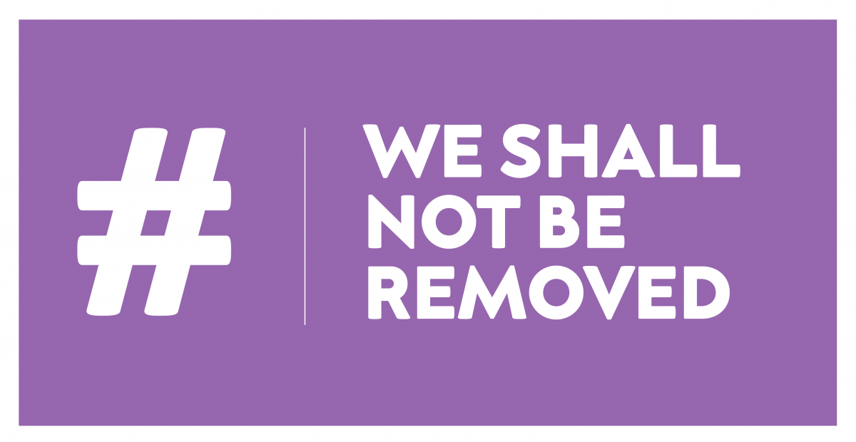 Image Description: A Purple Rectangle with a white border contains a large white hashtag symbol on the left, followed by a thin white line separator and then the words 'We Shall Not Be removed'