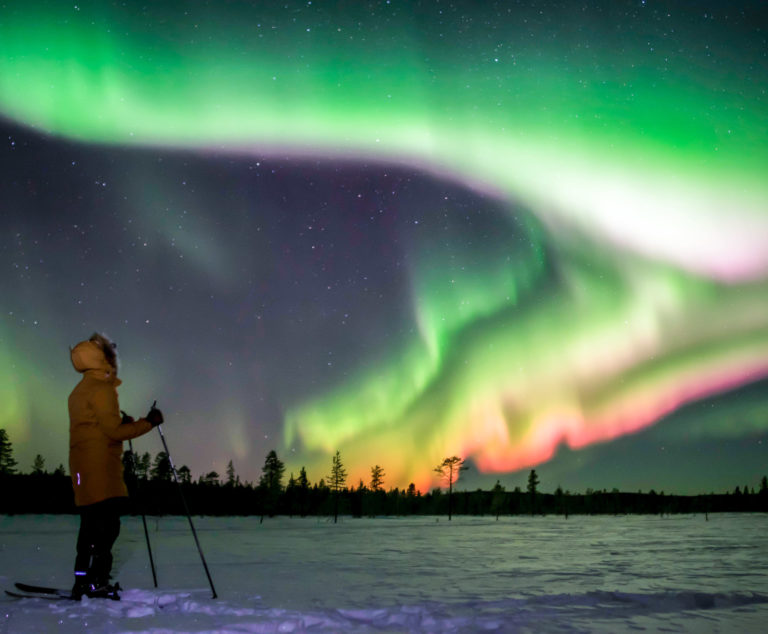 Wildmaker watching northern lights with skis