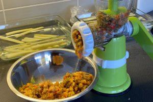 grinding salmon pate with coarse mesh ©️ Nel Brouwer-van den Berghs