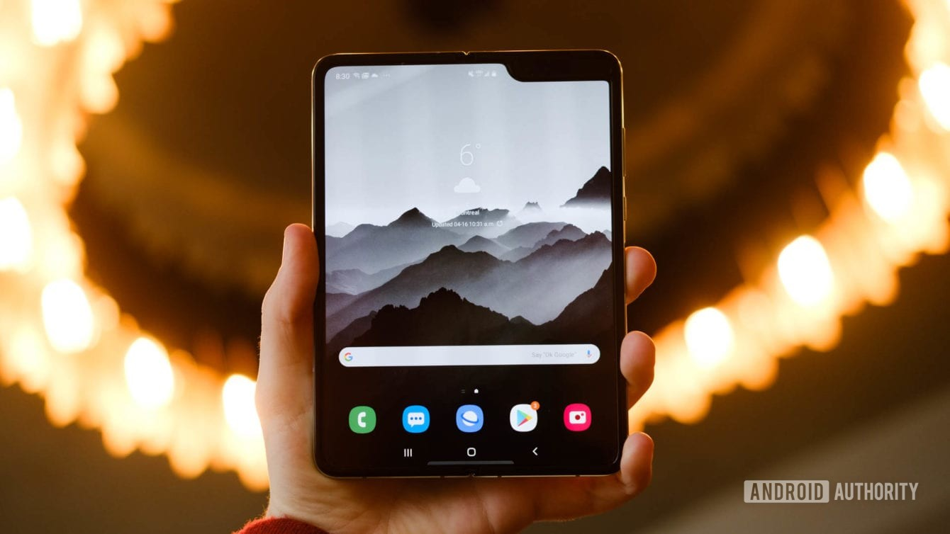 Samsung Galaxy Fold home screen in hand
