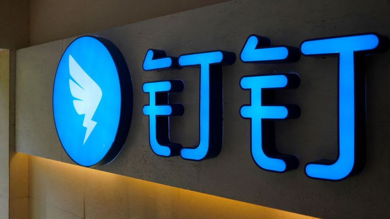 The logo of DingTalk is seen, an offshoot of Alibaba Group Holding Ltd, in Hangzhou, Zhejiang province, China