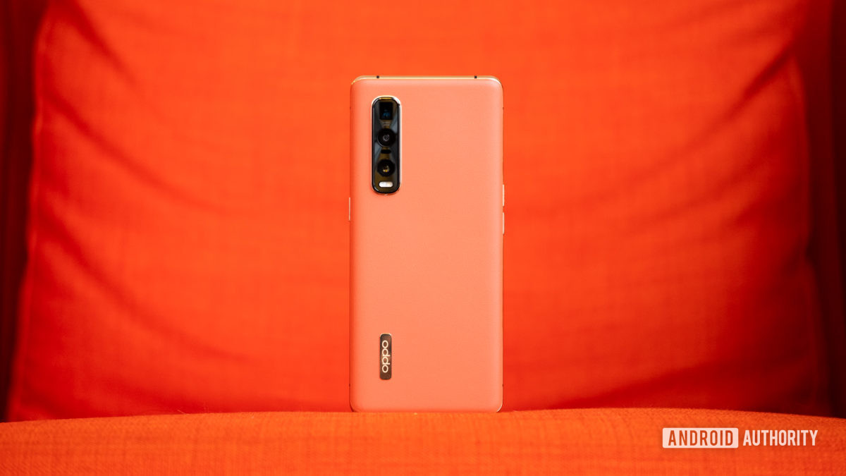 Oppo Find X2 Pro back against orage 1