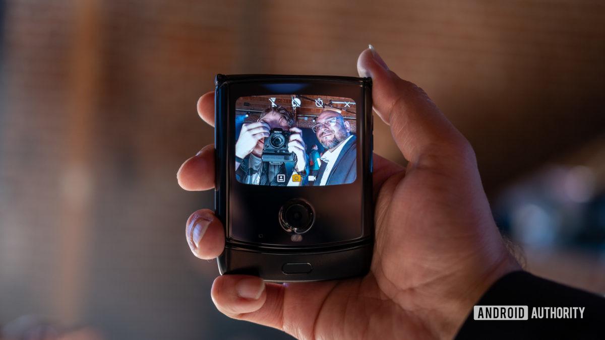 Moto Razr foldable folded screen in hand selfie