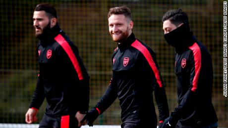 Arsenal's Shkodran Mustafi (center) and Mesut Ozil (right) have been gaming while football has been postponed.