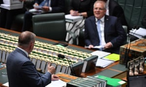 Leader of the Opposition Anthony Albanese taunts Prime Minister Scott Morrison with a Hawaiian hand gesture during Question Time in the House of Representatives at Parliament House in Canberra, Thursday, March 5, 2020.