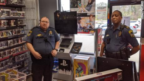 Police visit a GameStop in Athens, Georgia to order the store to shut down and comply with shelter-in-place rules.