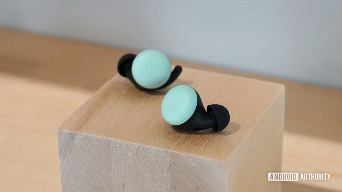Google Pixel Buds 2 in Quite Mint on a wooden block