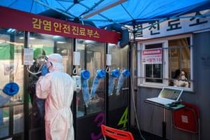 A nurse at testing booth outside the Yangji hospital in Seoul.