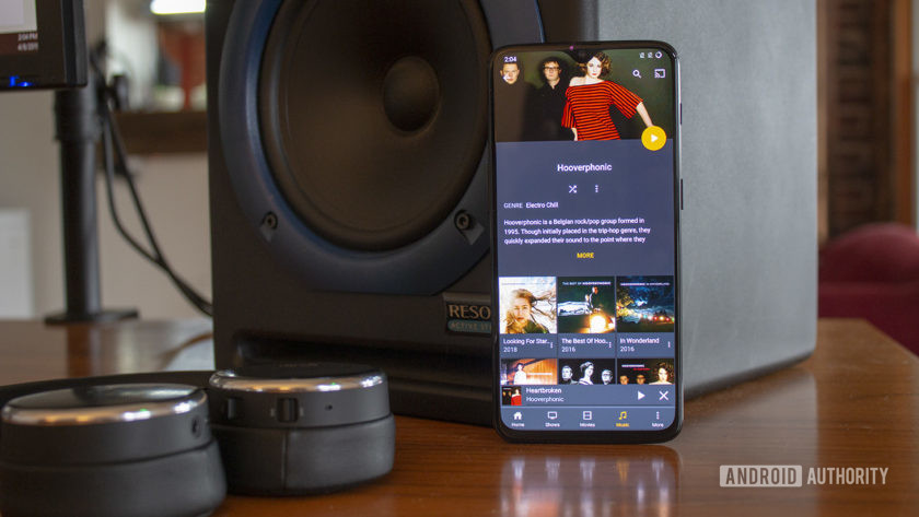 An image of a smartphone with the Plex music player on screen.