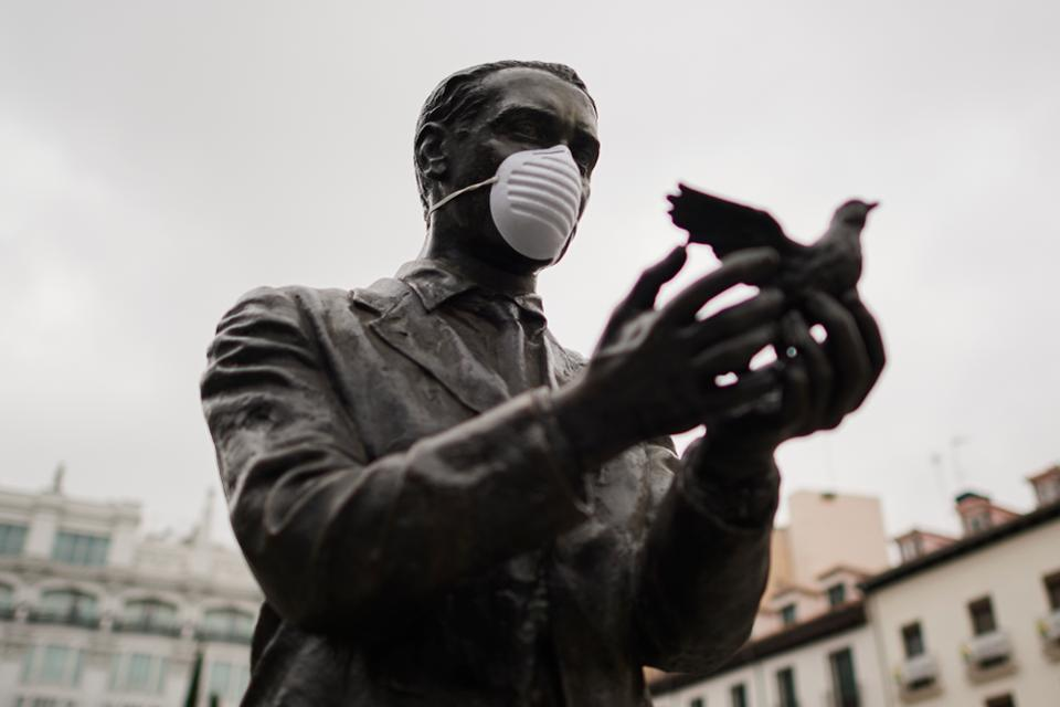 A facemask is seen on a statue of Spanish poet Federico Garcia Lorca
