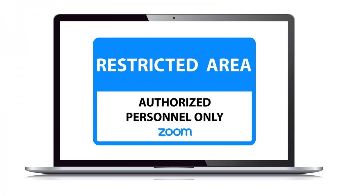 """An """"Authorizex Zoom Personnel Only"""" sign on a MacBook"""