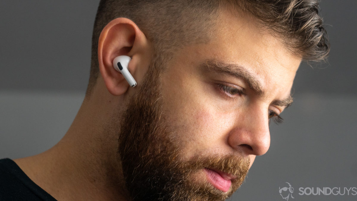 A picture of a man wearing the Apple AirPods Pro noise-canceling true wireless earbuds.