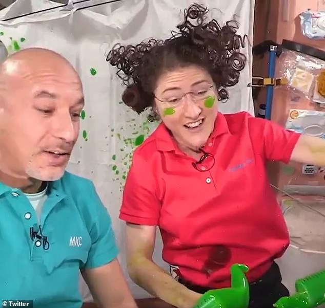 European Space Agency (ESA) astronaut Luca Parmitano (left) and NASA's Christina Koch (right) released the slime about the ship to see how the concoction would change in microgravity