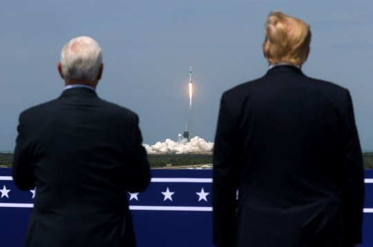 U.S. President Donald Trump and U.S. Vice President Mike Pence watch the launch of SpaceX Dragon