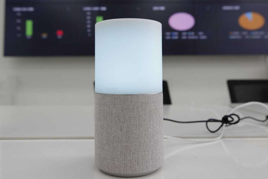 "SK Telecom's AI speaker Nugu built with an artificial intelligence called ""Aria"" and a lamp that turns blue when processing voice commands for news, music and internet searches, is seen in Seoul, South Korea, on May 13, 2020. The devices can also use quizzes to monitor the memory and cognitive functions of their elderly users, which would be potentially useful for advising treatments. Photo: Lee Jin-man, AP / Copyright 2020 The Associated Press. All rights reserved"