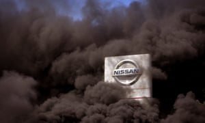 Smoke rises over the Nissan factory as workers burn tyres during a protest over the closure of the Barcelona plant.