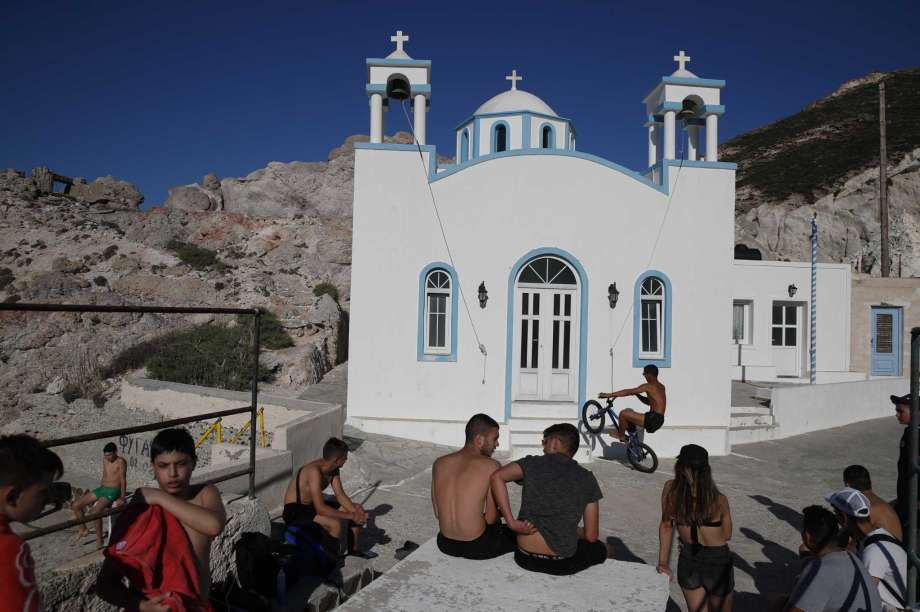 Children gather in front of a Greek Orthodox church on the Aegean Sea island of Milos, Greece, on Sunday, May 24, 2020. Greece's long-awaited tourist season will begin on June 15 with the opening of seasonal hotels and the arrival of the first foreign visitors, while international flights will begin heading directly for holiday destinations gradually as of July 1. Photo: Thanassis Stavrakis, AP / Copyright 2020 The Associated Press. All rights reserved