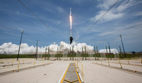 In this photo provided by NASA, a SpaceX Falcon 9 rocket carrying the company's Crew Dragon spacecraft is launched from Launch Complex 39A on NASA's SpaceX Demo-2 mission to the International Space Station with NASA astronauts Robert Behnken and Douglas Hurley onboard, Saturday, May 30, 2020, at NASA's Kennedy Space Center in Cape Canaveral, Florida. (Bill Ingalls/NASA via AP)