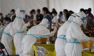 Medical workers swab test people for Covid-19 amid the coronavirus outbreak on 28 June 2020 in Beijing, China.