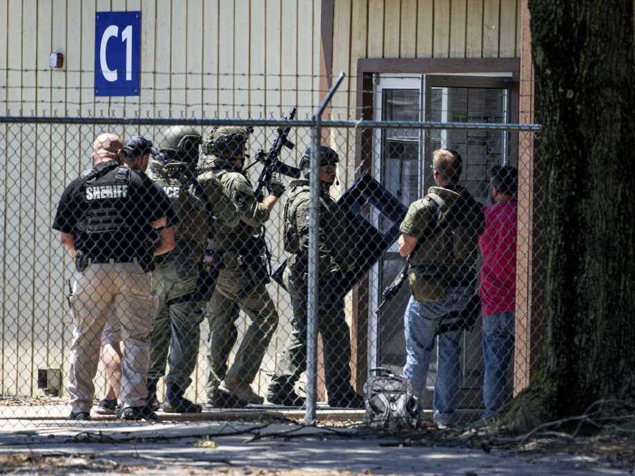 Law enforcement enter the C1 building to the west of the Bunn-O-Matic warehouse during an active shooter situation, Friday, June 26, 2020, in Springfield, Ill. Police say officers are searching for a gunman at a warehouse in the Illinois state capital after at least one person was shot and wounded. (Justin L. Fowler/The State Journal-Register via AP) Photo: Justin L. Fowler, AP / 2020 The State Journal-Register