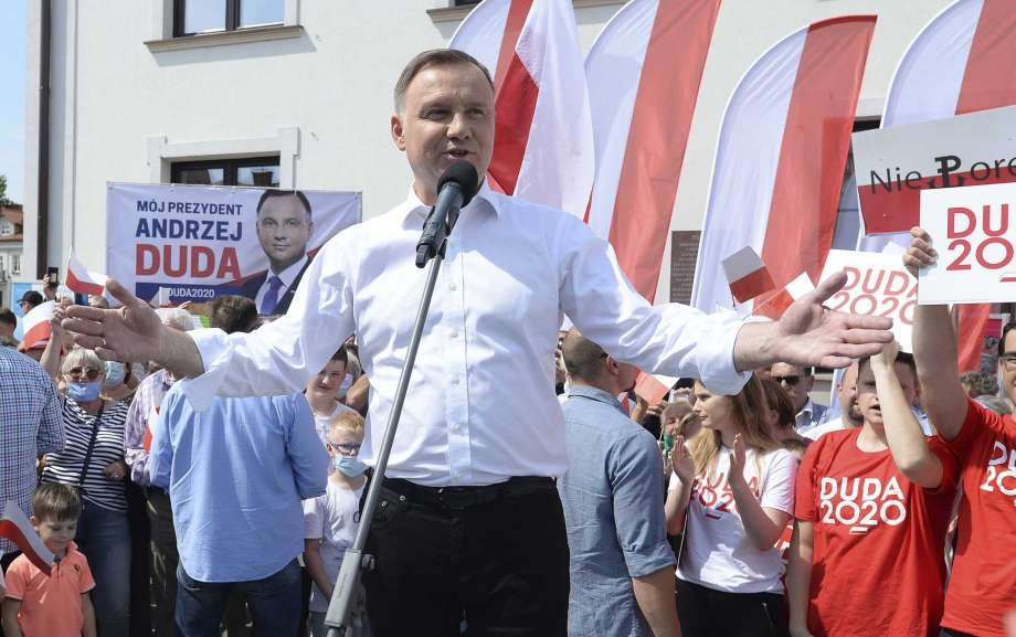 FILE - In this Wednesday, June 17, 2020 file photo, Polish President Andrzej Duda waves to supporters as he campaigns for a second term in Serock, Poland.Polands current President Andrzej Duda is the frontrunner ahead of the election on Sunday, June 28, but polls show him unlikely to achieve the majority needed to win outright. That will require a runoff two weeks later in which he is expected to face off against Warsaw Mayor Rafal Trzaskowski in a very close race. Photo: Czarek Sokolowski, AP / Copyright 2020 The Associated Press. All rights reserved.