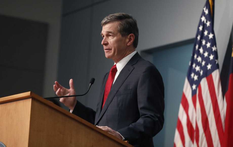 North Carolina Gov. Roy Cooper speaks during a briefing at the Emergency Operations Center in Raleigh, N.C., Tuesday, June 2, 2020. (Ethan Hyman/The News & Observer via AP) Photo: Ethan Hyman, AP / 2020, The News & Observer