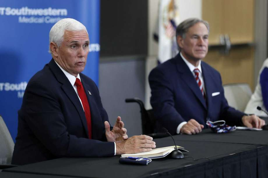 Vice President Mike Pence, left, and Texas Gov. Greg Abbott, right, respond to questions during a news conference after Pence met with Abbott and members of his health care team regarding COVID-19 at the University of Texas Southwestern Medical Center West Campus in Dallas, Sunday, June 28, 2020. Photo: Tony Gutierrez, AP / Copyright 2020 The Associated Press. All rights reserved.