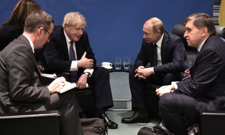 Boris Johnson (centre left) speaks with Russian president Vladimir Putin (centre right) during the International Libya Conference in Berlin, Germany, 19 January 2020.
