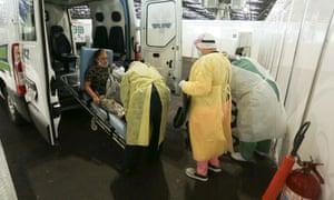 A coronavirus patient is transported amid the coronavirus outbreak in Sao Paulo, Brazil, 7 Jul 2020.