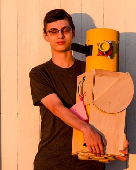 Zane Landers, 17, with one of his homemade telescopes.