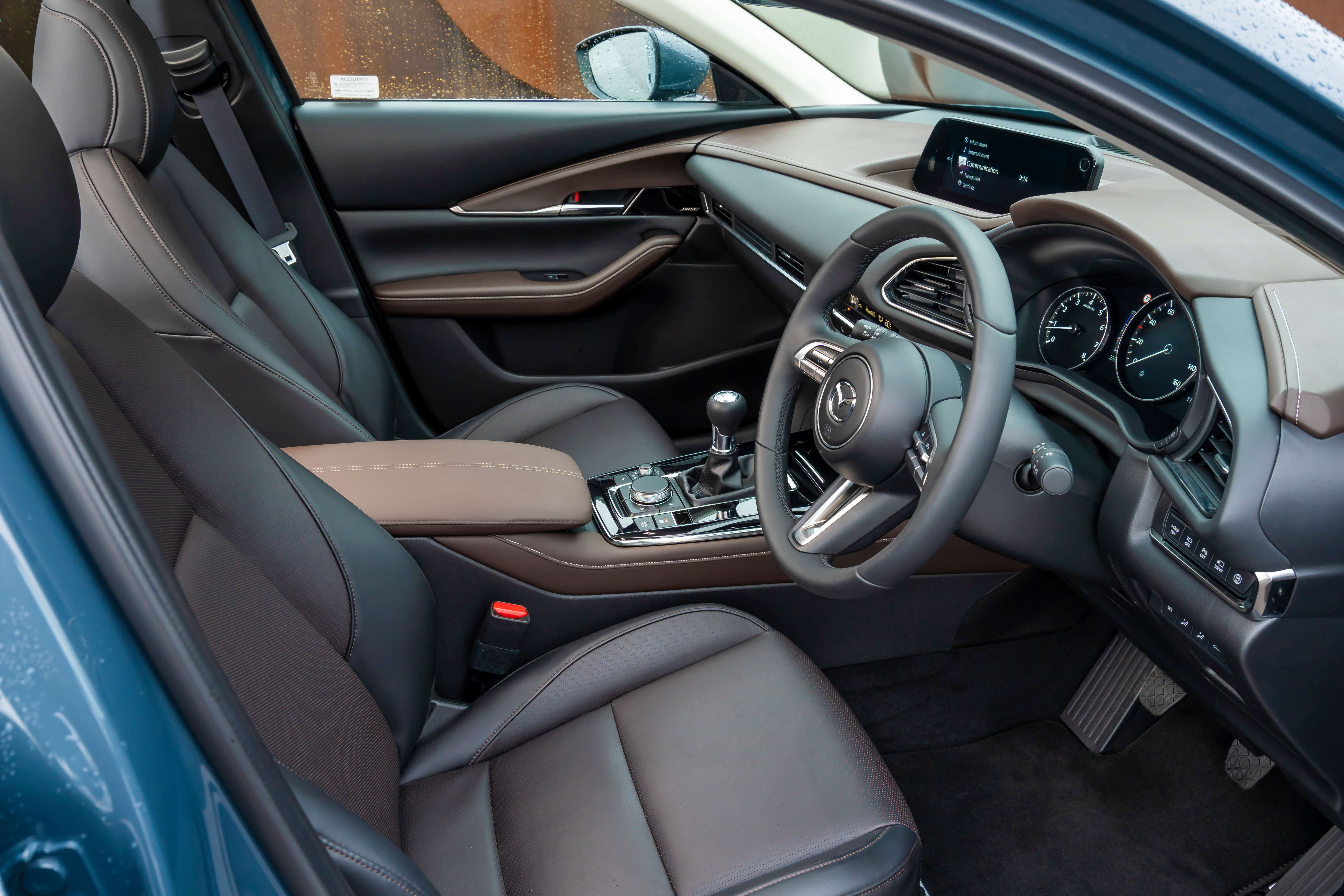 The Mazda includes leather upholstery, powered front seats, head-up display, heated steering wheel, keyless entry and go, and a 12-speaker Bose sound system
