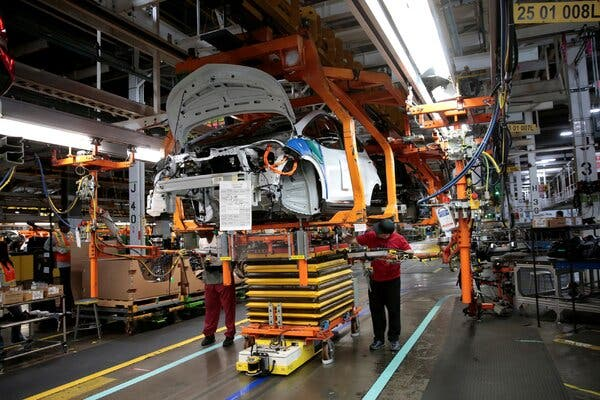 General Motors workers on an assembly line in Lake Orion, Mich., in 2018.