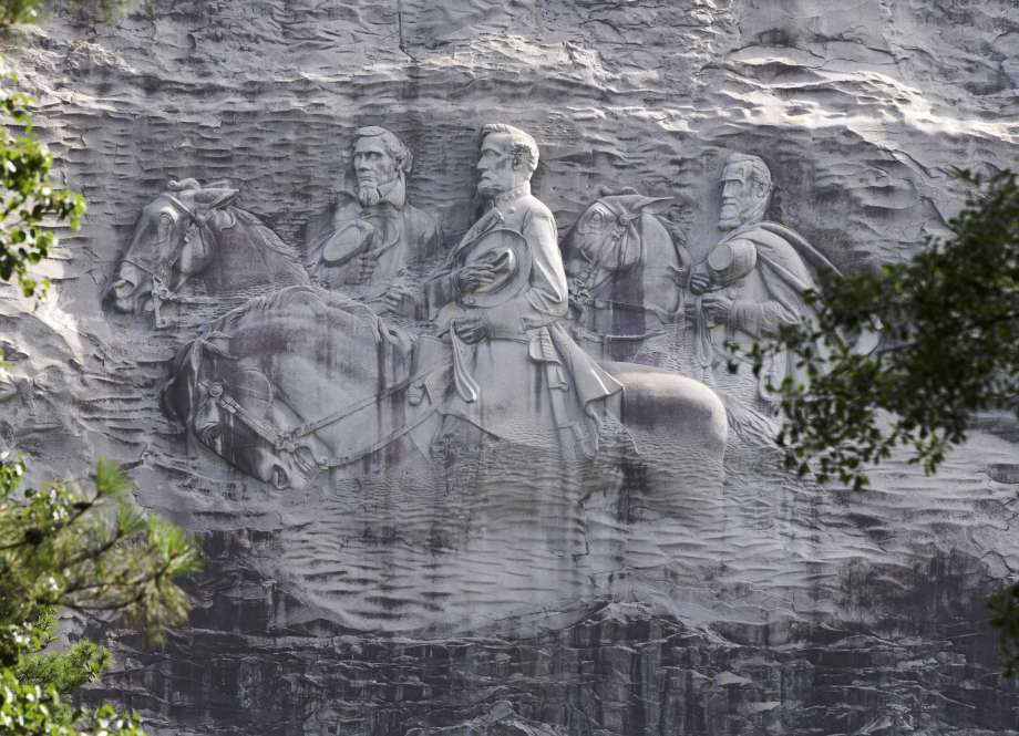 FILE - This June 23, 2015 file photo shows a carving depicting Confederate Civil War figures Stonewall Jackson, Robert E. Lee and Jefferson Davis, in Stone Mountain, Ga. The sculpture is America's largest Confederate memorial. Photo: John Bazemore, AP / Copyright 2017 The Associated Press. All rights reserved.