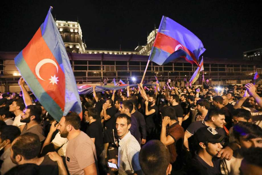 People carry Azerbaijn's national flags as they rally in support of Azerbeijan's Army in Baku, Azerbaijan, Tuesday, July 14, 2020. Skirmishes on the volatile Armenia-Azerbaijan border escalated Tuesday, marking the most serious outbreak of hostilities between the neighbors since the fighting in 2016. Photo: Aziz Karimov, AP / Copyright 2020 The Associated Press. All rights reserved.