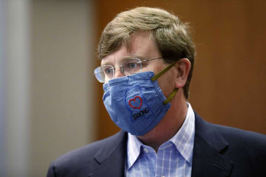 """Gov. Tate Reeves sports a """"Mississippi Strong"""" face mask following his coronavirus news briefing in Jackson, Miss., Wednesday, July 8, 2020. Reeves and other state officials provided reporters an update on the coronavirus and the state's ongoing strategy to limit transmission. Photo: Rogelio V. Solis, AP / Copyright 2020 The Associated Press. All rights reserved"""