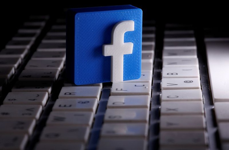 FILE PHOTO: A 3D-printed Facebook logo is seen placed on a keyboard in this illustration taken March 25, 2020. REUTERS/Dado Ruvic/File Photo