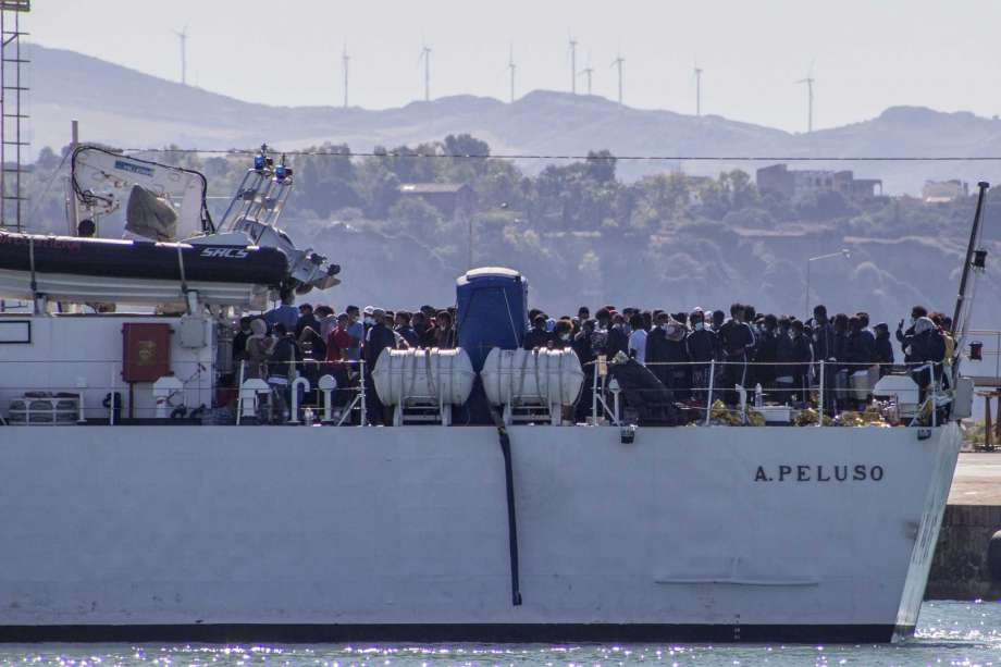 Migrants arrive in Porto Empedocle, Sicily, aboard two military ships after being transferred from the island of Lampedusa, where a number of small boat carrying migrants arrived in the last days, Monday, July 27, 2020. (Fabio Peonia/LaPresse via AP) Photo: Fabio Peonia, AP / LaPresse