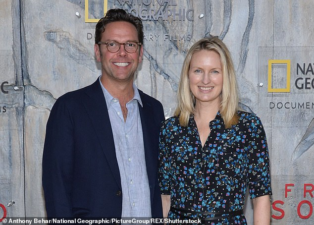 Payday:James Murdoch, with wife Kathryn, is a non-executive director at Tesla