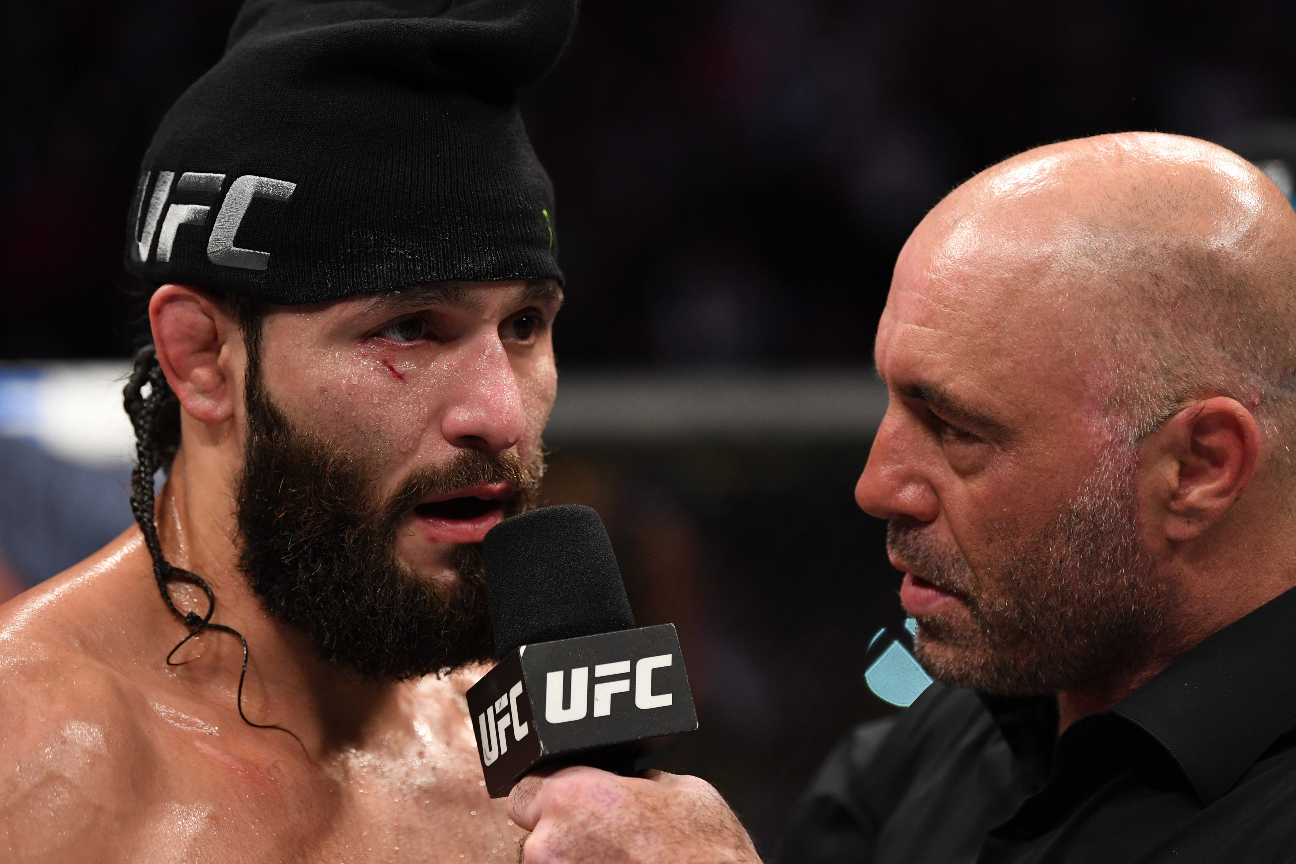 Joe Rogan, pictured alongside UFC 4 cover star Jorge Masvidal, will not be the voice on commentary for the video game