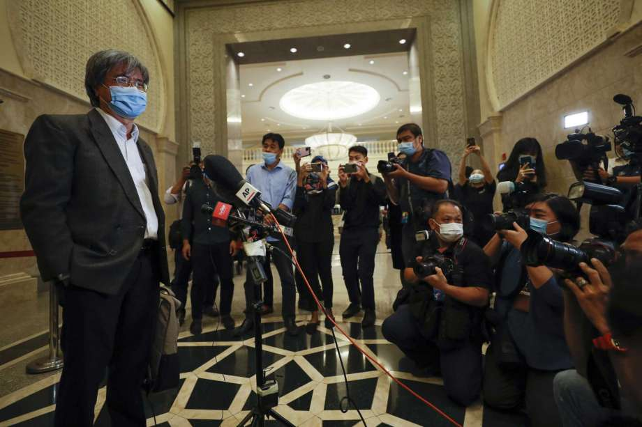 In this picture taken Thursday, July 2, 2020, show Steven Gan, left, editor-in-chief of Malaysiakini online news portal arrive at court in Putrajaya, Malaysia, Monday, July 13, 2020. Attorney General Idrus Harun, who was appointed by a new government that took power in March, filed contempt proceedings against Malaysiakini and Gan over comments made by five readers on its portal last month that allegedly tarnished the judiciary. Photo: Vincent Thian, AP / Copyright 2020 The Associated Press. All rights reserved