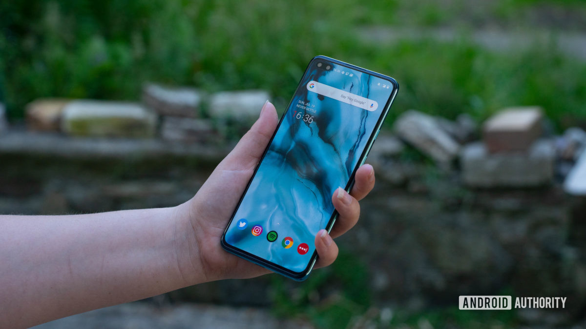 OnePlus Nord Holding the phone looking at the home screen