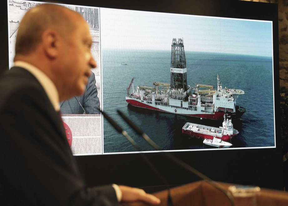 """Turkey's President Recep Tayyip Erdogan speaks with Turkish drilling ship, Fatih, in background, in Istanbul, Friday, Aug. 21, 2020. Erdogan has announced the discovery of a large natural gas reserves off the Black Sea coast, days after he promised """"good news"""" that would usher in a """"new era"""" for the energy dependent country.(Turkish Presidency via AP, Pool) Photo: AP / Turkish Presidency"""