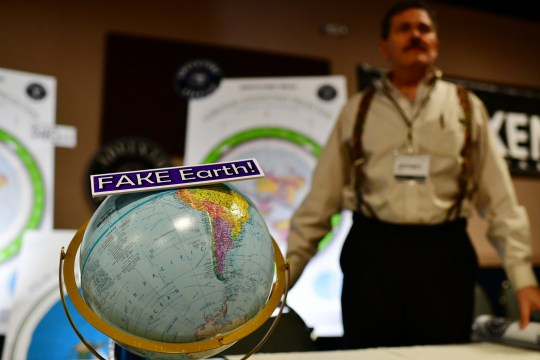 DENVER, CO - NOVEMBER 15: Jeffrey Diaz, right, is selling flat earth maps at his booth during Flat Earth International Conference at Crowne Plaza Denver Airport. November 15, 2018. Hundreds of people who believe the Earth is flat attended the conference. (Photo by Hyoung Chang/The Denver Post via Getty Images)