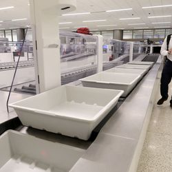 Lincoln Franke makes his way through the Transportation Security Administration Precheck security lane at the new Salt Lake City International Airport on Tuesday, Sept. 22, 2020.