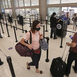 Travelers make their way through the Transportation Security Administration checkpoint at the new Salt Lake City International Airport on Tuesday, Sept. 22, 2020.