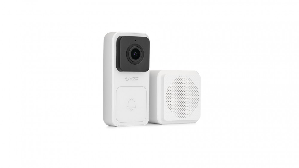 A Wyze video doorbell next to a white chime.