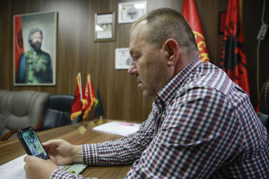 Hysni Gucati head of the War Veterans Organization of the Kosovo Liberation Army looks at a photo of his co-fighter former Kosovo Liberation Army commander Salih Mustafa after news of his arrest,  during an interview with The Associated Press, in Pristina, Thursday, Sept. 24, 2020. A special international court said Thursday that a former commander of the separatist fighters in Kosovo's 1998-1999 war has been arrested as part of a war crimes and crimes against humanity probe stemming from the conflict with Serbia. Photo: Visar Kryeziu, AP / Copyright 2020 The Associated Press. All rights reserved.