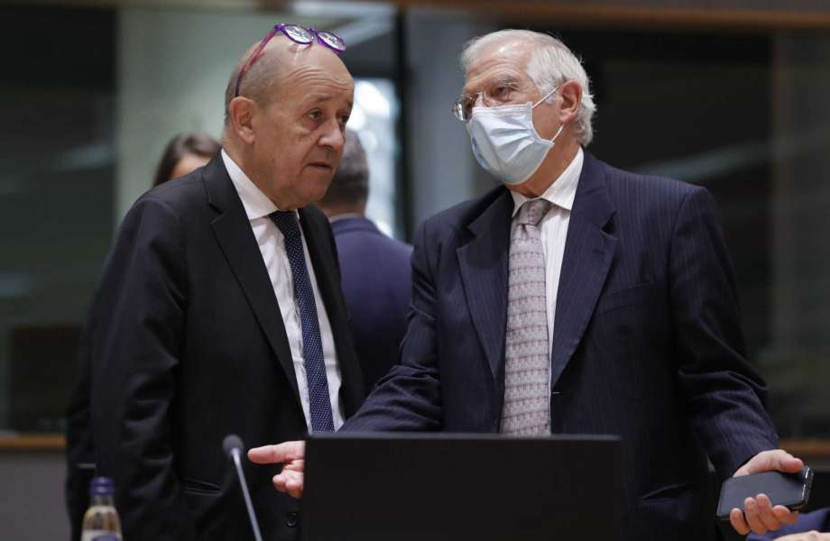 French Foreign Minister Jean-Yves Le Drian, left, speaks with European Union foreign policy chief Josep Borrell during a meeting of EU foreign affairs ministers at the European Council building in Brussels, Monday, Sept. 21, 2020. (Olivier Hoslet, Pool via AP) Photo: Olivier Hoslet, AP / Pool EPA